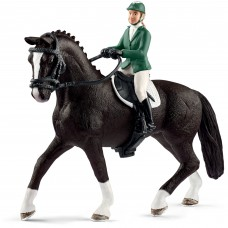 Schleich Showjumper Figure with Horse Figure   562994403